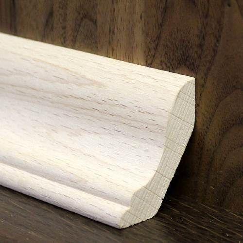 Масивна рейка для переходу між підлогою та стінами з бука.